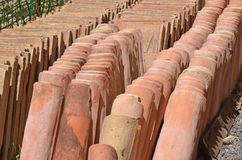 Roman roof tiles. Collection of ancient roman roof tiles (flat and curved) at an archeological dig Stock Images