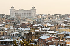 Roman roofs with snow. Rome's cityscape with snow. Vittoriano in background Royalty Free Stock Image