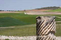 From the roman ruins. A broken column in the roman ruins of segobriga (Spain Royalty Free Stock Photo