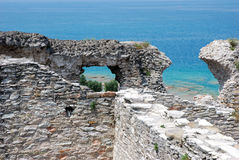 Roman ruins. Part of the ruins of Catull Grottos, built on the peninsula of Sirmione, Lake Garda, Italy Royalty Free Stock Photo