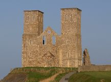 Roman Ruins of Reculver Church, Kent. Medieval towers and the roman ruins of St Marys Church sometimes known as Reculver Castle in Kent, England. An important Stock Photo