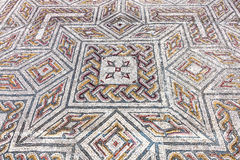 Roman ruins of Conimbriga. Close-up on a complex Roman tessera mosaic pavement center Stock Image