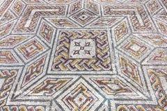 Roman ruins of Conimbriga. Close-up on a complex Roman tessera mosaic pavement center. Close-up on a complex Roman tessera mosaic pavement center. Swastika Domus Stock Image