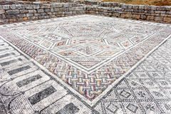 Roman ruins of Conimbriga. Complex and elaborate Roman tessera mosaic pavement in the House of the Skelletons Stock Photos
