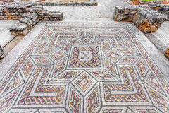 Roman ruins of Conimbriga. Complex and elaborate Roman tessera mosaic pavement in the House of the Swastika Stock Photos