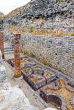 Roman ruins of Conimbriga. The defensive wall of Conimbriga was built in desperation and cuts through the Cantaber Domus garden. The defensive wall of Conimbriga Stock Image