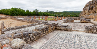 Roman ruins of Conimbriga. Overal view of the Swastika Domus. With the rooms, the peristyle and garden. Conimbriga, in Portugal, is one of the best preserved Royalty Free Stock Image