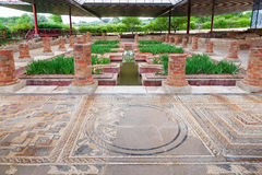 Roman ruins of Conimbriga. Roman Domus of Fountains. Roman Domus of Fountains. View of the interior garden, peristyle, and pond with very ornate mosaics Royalty Free Stock Photos