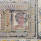 Roman ruins of Conimbriga. Roman mosaic portraying the Autumn Season or Fall character Royalty Free Stock Photo