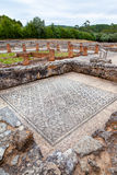 Roman ruins of Conimbriga. Room on the Domus of the Swastika. Room on the Domus of the Swastika, decorated with mosaics with a view on the peristyle, garden and Royalty Free Stock Photography