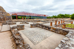 Roman ruins of Conimbriga. The Swastika Domus, and structure protecting the Fountains Domus in the back. Conimbriga, in Portugal, is one of the best preserved Royalty Free Stock Photo