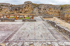 Roman ruins of Conimbriga. View of the House of the Swastika, the mosaics and Defensive Wall Royalty Free Stock Image