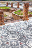 Roman ruins of Conimbriga. View of the inner pond and garden with the Peristyle columns and mosaic floor Royalty Free Stock Image