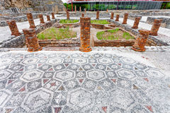 Roman ruins of Conimbriga. View of the inner pond and garden with the Peristyle columns and mosaic floor, on the Swastika Domus. Royalty Free Stock Photography