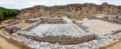 Roman ruins of Conimbriga. View of the Skeletons Domus. In the back the Defensive Wall of the city. Conimbriga, in Portugal, is one of the best preserved Roman Royalty Free Stock Photo