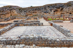 Roman ruins of Conimbriga. View of the Skeletons Domus. In the back the Defensive Wall of the city. Conimbriga, in Portugal, is one of the best preserved Roman Royalty Free Stock Photography