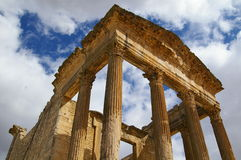 Roman ruins in Dougga, Tunisia. The ruins of the Temple of Saturn against the sky royalty free stock photo