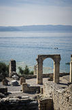Roman ruins on Garda Lake in Sirmione, Italy royalty free stock images