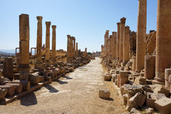 Roman ruins, Jerash. An ancient street lined with columns in the ruins of the Roman city of Jerash, Jordan Royalty Free Stock Photos