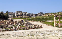 Roman ruins. Of Jerash in Jordan on a sunny day with the houses of the city in the background.You can see some tourist. It´s aeditorial picture Royalty Free Stock Images