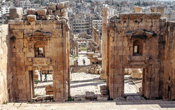 Roman ruins. Of Jerash in Jordan on a sunny day with the houses of the city in the background.You can see some tourist. It´s a editorial picture royalty free stock photography