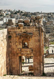 Roman ruins. Of Jerash in Jordan on a sunny day with the houses of the city in the background.You can see some tourist. It´s aeditorial picture royalty free stock image