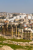 Roman ruins. Of Jerash in Jordan on a sunny day You can see the houses in the background. It´s a editorial picture in vertical stock photography