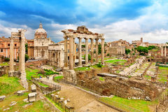 Roman ruins in Rome, Forum. Ancient ruins of the Romanum Forum. Ruins of Septimius Severus Arch and Saturn Temple, Rome, Italy Royalty Free Stock Photo
