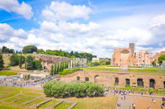 Roman ruins in Rome, Italy. Tourists visit the vestiges of Foro Romano Roman Forum in Rome, Italy on a summer day Royalty Free Stock Photography