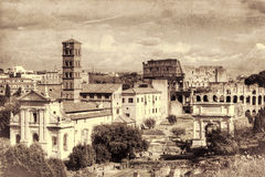 Roman ruins in Rome. Retro toned. Roman ruins in Rome. The Temple of Venus and Roma, Church of Santa Francesca Romana, The Arch of Titus, The Colosseum. Rome Royalty Free Stock Photography
