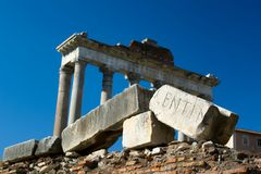 Roman ruins and temple. Roman ruins on wall in front of temple on Forum Romanum - Rome, Italy Stock Image