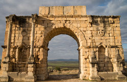 Roman ruins in Volubilis. Main gate of roman city ruins in Volubilis Stock Photo
