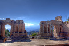 Roman ruins, vulcaono etna, Taormina, Sicily, Italy. The ruins of the stage of the Roman theater in Taormina, Sicily, Italy, with the Etna Vulcano mountain on Stock Images