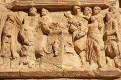 Roman Sacrifice frieze. Roman frieze showing a sacrifice of oxen. Stone carving on the magnificent triumphal arch of Emperor Septimus Severis at Leptis Magna in royalty free stock photo