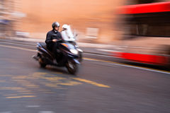 Roman scooter with motion blur Royalty Free Stock Images