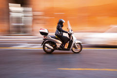 Roman scooter with motion blur Royalty Free Stock Photos