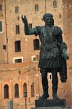 Roman Sculpture. A Roman sculpture with a backdrop of Roman ruins Royalty Free Stock Image