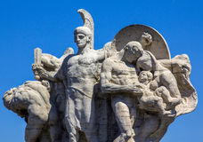 Roman sculpture of a warrior-defender. Ancient sculpture of the Roman warrior-defender against a blue sky Royalty Free Stock Images