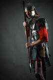 Roman soldier in armor with a spear in hand Royalty Free Stock Photography