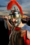 Roman Soldier With Calvary in Background Stock Images