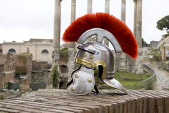 Roman soldier helmet in front of ancient roman ruins. Stock Photos
