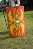 Roman soldier holding shield. Close up of Roman soldier holding colorful shield Stock Photo