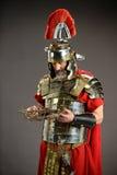 Roman Soldier Honding Crown de espinas Fotos de archivo libres de regalías
