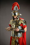 Roman Soldier Honding Crown of Thorns Royalty Free Stock Photos