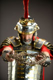 Roman Soldier Honding Crown of Thorns Stock Images