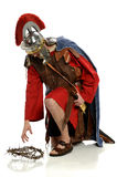 Roman Soldier Reaching For Crown von Dornen Lizenzfreies Stockfoto