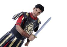 Roman soldier with sword. Man dressed in uniform of Roman soldier or centurion with sword, white background Royalty Free Stock Photo