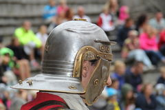 Roman Soldier wearing an helmet. A roman soldier wearing a helmet during a gladiator fight, performed in the Dutch theme park Archeon Royalty Free Stock Image