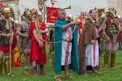 Roman soldiers in battle costume and musicants Stock Photography