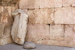 Roman statue and ancient wall background Stock Images